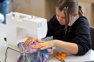 Student working on sewing machine